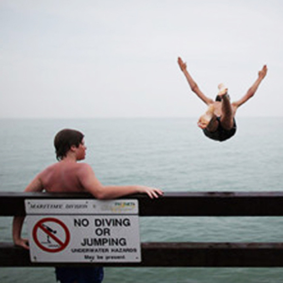 diving in front of a no diving sign, behind the mirror, rules to break, beauty rules to break