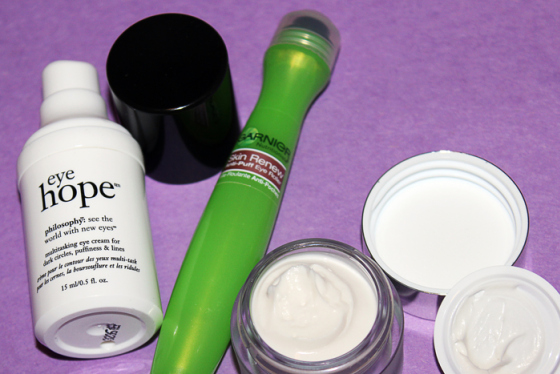 Summer Magic Eyes, Behind the Mirror, Philosophy Eye Hope, Garnier Anti-puff roller, Clinique anti-gravity eye cream, purple background