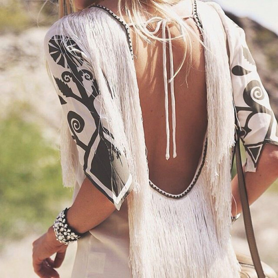 open back dress with tribal prints on the sleeves