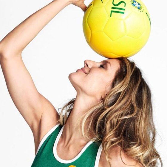 gisele holding a yellow soccer ball to celebrate the world cup in brazil