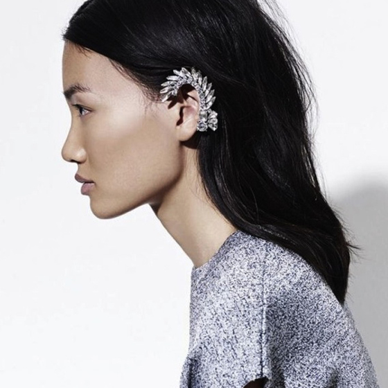 asian girl with long hair in grey sweater with ear cuff wrapped around the top of ear