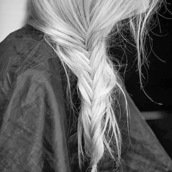 long fish braid on girl with grey silver hair, behind the mirror, like your face